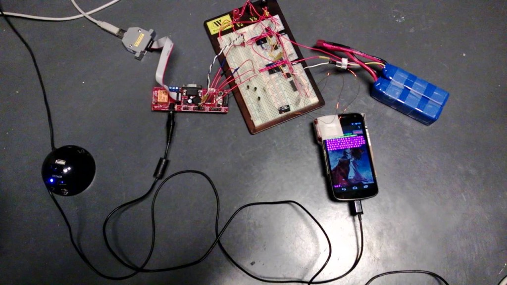 Photograph of the Pulse system. Note that 2 solenoids are attached to the top and the side of the phone using adhesive tape.
